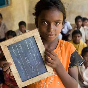 Dhina Kumari, brick factory worker and pupil, pictured in the village school.